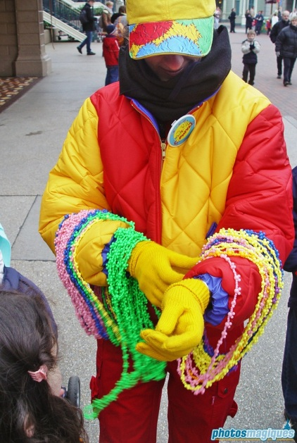 Cast Member handing out beads